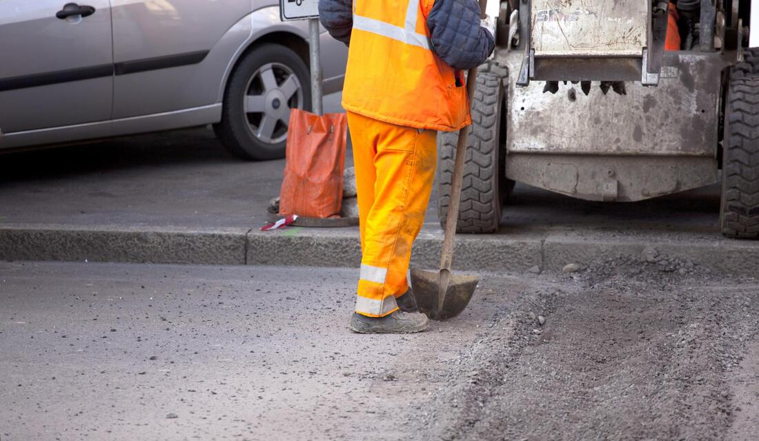 worker doing asphalt maintenance